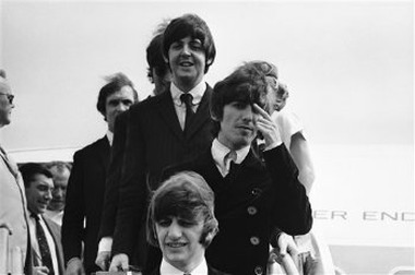 The Beatles leave a Pan Am plane in Boston, Aug. 11, 1966, after a flight from London. (AP Photo)
