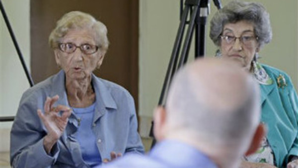 Margarita Satut, 91 left, explains to Gov. Rick Scott how Medicare Advantage cuts will affect her during a discussion in Miami, Wednesday, April 9, 2014. (AP Photo/Alan Diaz)