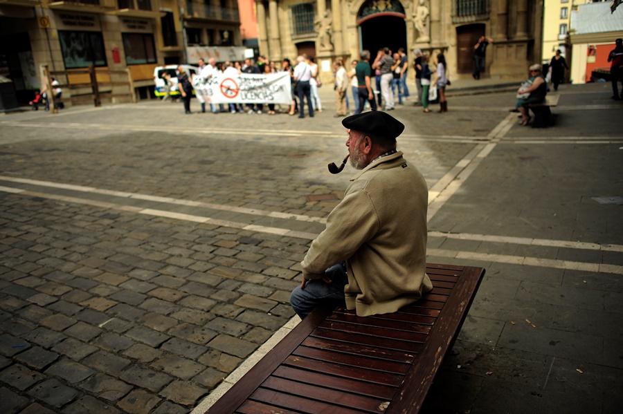 older man smoking pipe