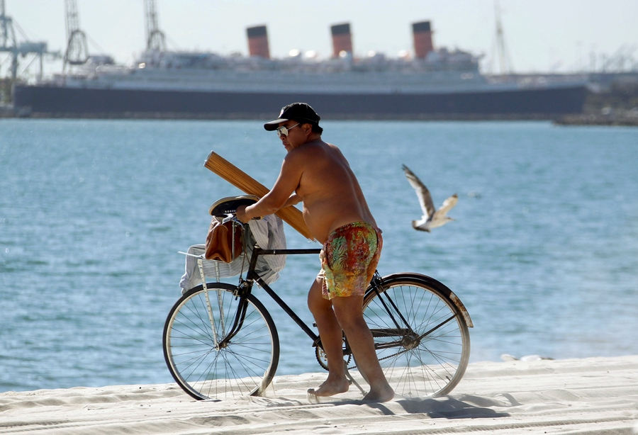 Beach scene with man on bicycle, California (Photo: AP)