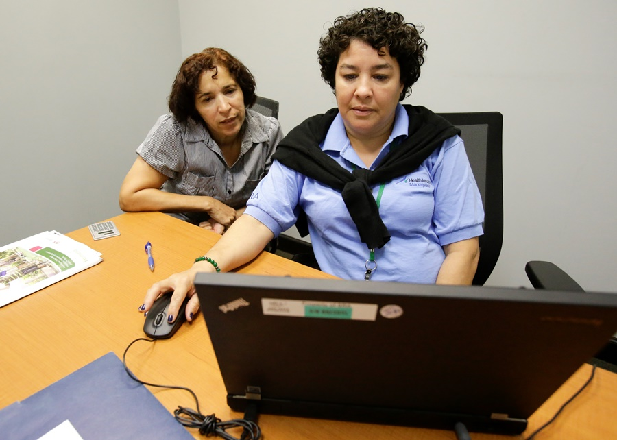 Two women at computer (photo: AP)