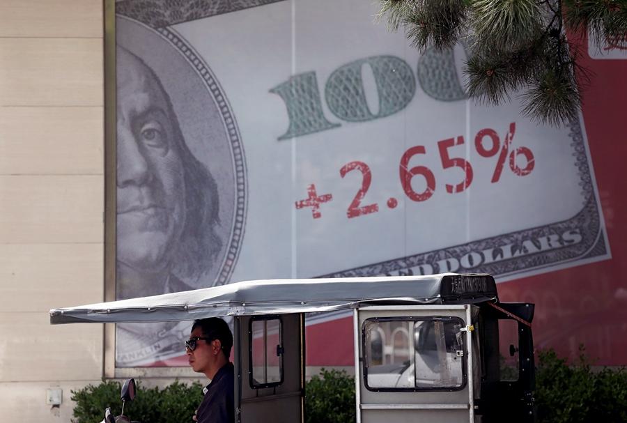 Dollar bill sign on wall (photo: AP)