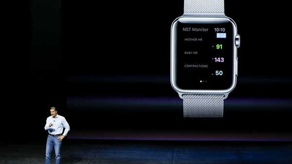 Dr. Cameron Powell with Airstrip, talks about health monitor options on the Apple Watch during the Apple event in San Francisco, Sept. 9, 2015. (AP Photo/Eric Risberg)