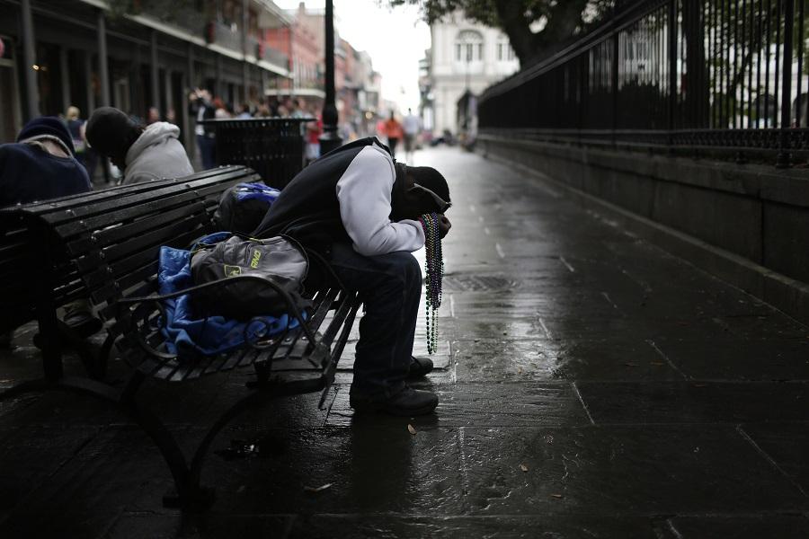 Man asleep in New Orleans (photo: AP)