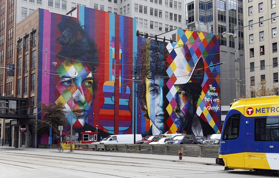 A mural of folk-rock legend and Minnesota native Bob Dylan by Brazilian artist Eduardo Kobra and his team of five artists adorns the wall of a building, Friday, Sept. 11, 2015, in downtown Minneapolis. (AP Photo/Jim Mone)