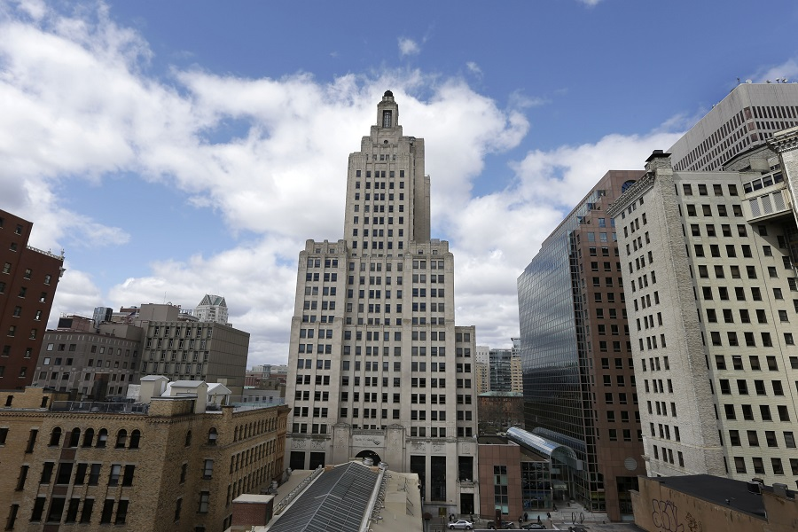"The Bank of America Building, center, stands in downtown Providence, R.I. The building is known to some as the ""Superman building,"" for its similarity to the Daily Planet headquarters in the old Superman TV show. (AP Photo/Steven Senne)"