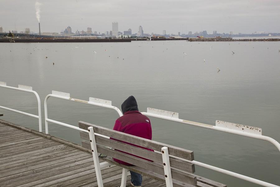 A woman sketches a scene of Milwaukee's lakefront Tuesday, Feb. 1, 2012, in Milwaukee. (AP Photo/Jeffrey Phelps)