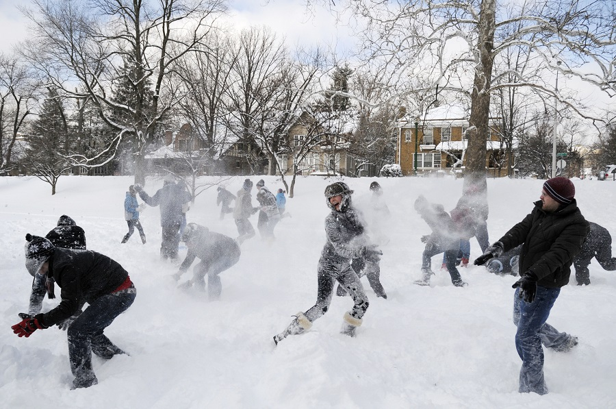 Students battle in a snowball fight on the Indiana University campus in Bloomington, Ind. (AP Photo/Indiana Daily Student, James Brosher)