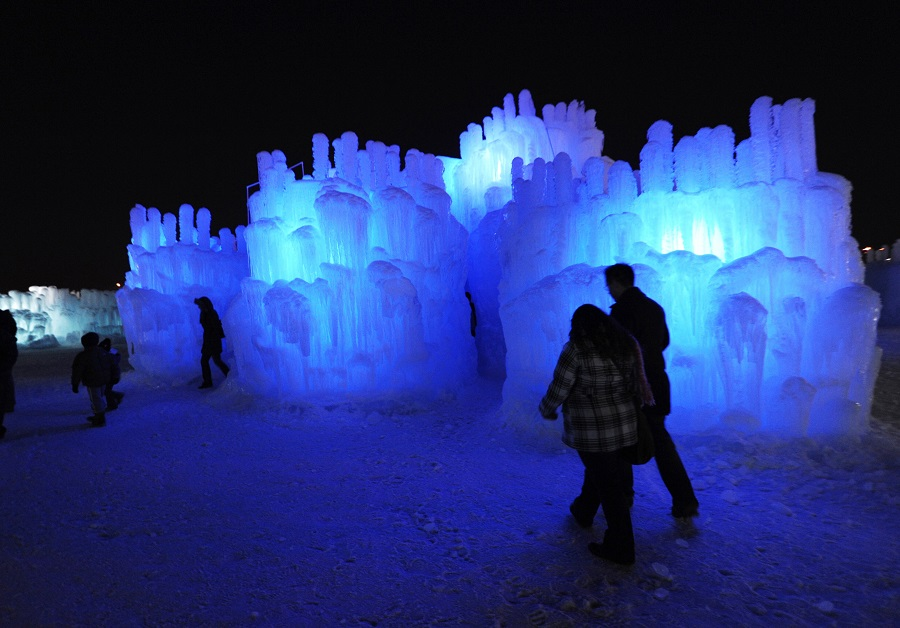 Visitors explore the Mall of America Ice Castle Friday, Jan. 4, 2013 in Bloomington, Minn. The castle is made of icicles organically grown from four million gallons of water and then fused together. (AP Photo/Jim Mone)
