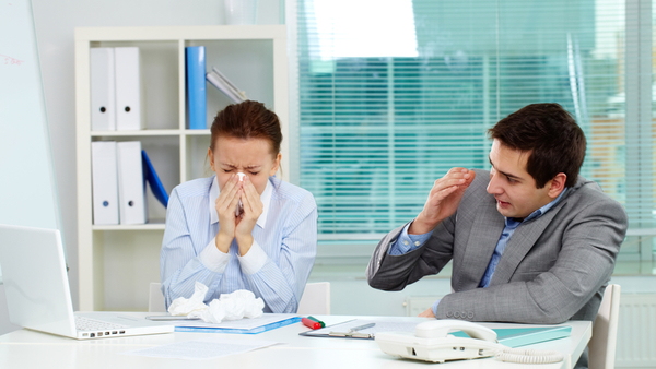 Even with sick leave or paid time off, many ill employees still go to work. (Photo: iStock)