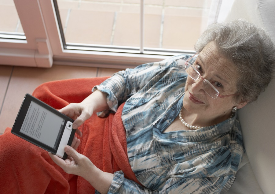 Older woman reading an e-book (Photo: Getty)