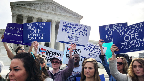 Demonstrators outside the U.S. Supreme Court on the day of arguments in the case Zubik v Burwell on March 23, 2016. (Photo: Diego M. Radzinschi, The National Law Journal)