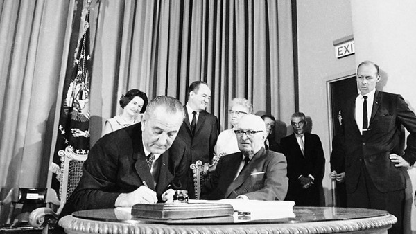 GOP state legislators in a number of states have said it's time to accept Medicaid expansion. (Photo of Pres. Johnson signing Medicaid into law,1965: AP)