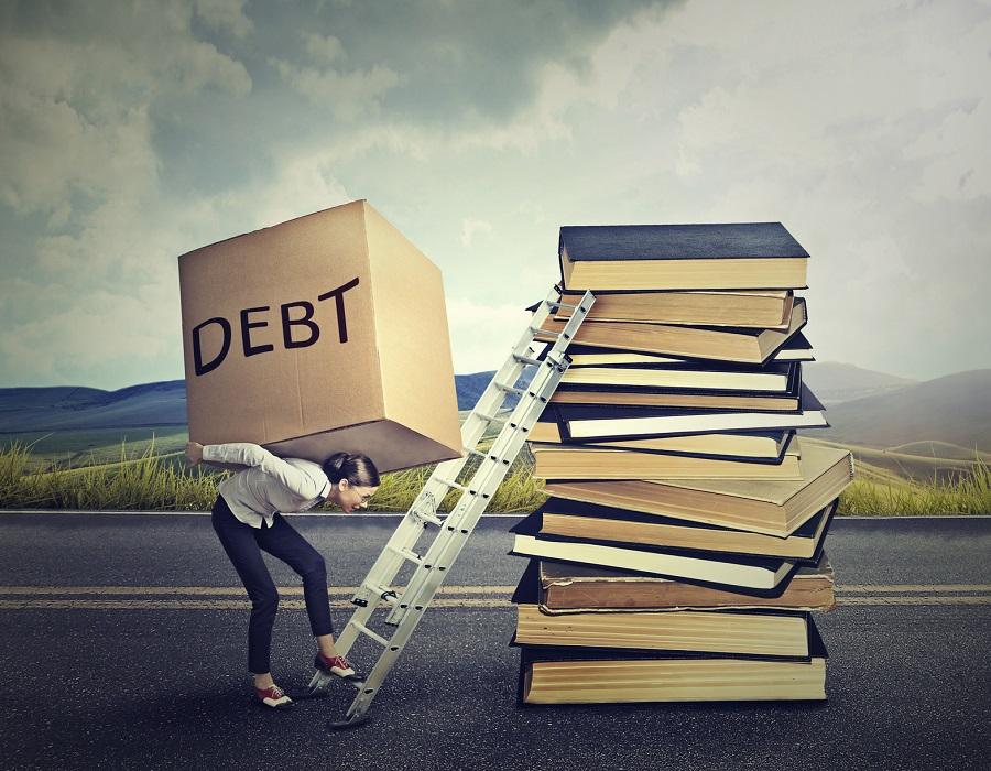 Millennial women shoulder a lot of student debt. (Photo: Getty)