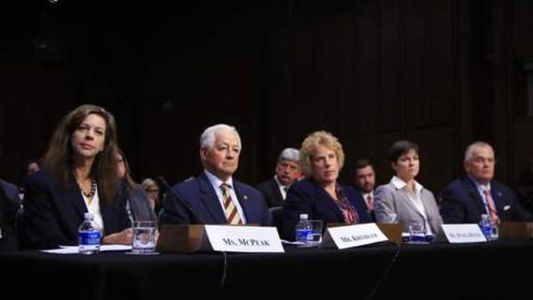 Tennessee Department of Commerce and Insurance Commissioner Julie Mix McPeak (left), and other state insurance commissioners testify during a Senate, Health, Education, Labor, and Pensions Committee hearing in Washington, Sept. 6, 2017. (AP Photo/Manuel Balce Ceneta)