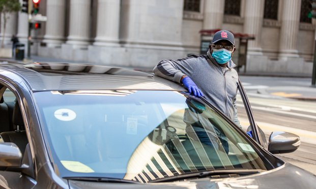 Uber driver wearing a mask