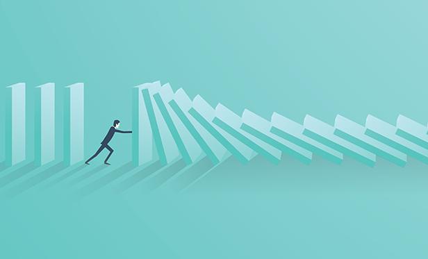 Stock illustration: Businessman stops falling dominoes