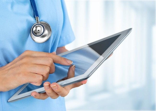medical professional with tablet