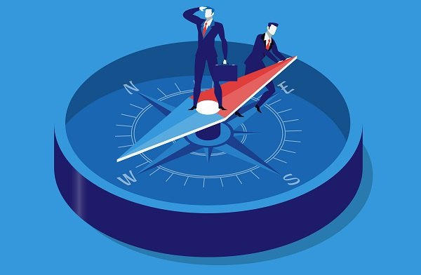 Businessman on compass illustration