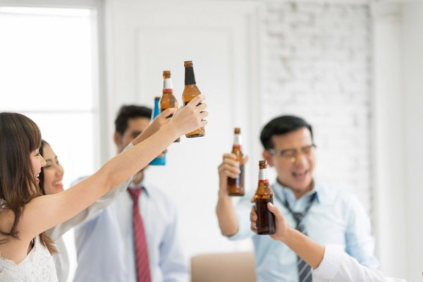 Young employees drinking beer