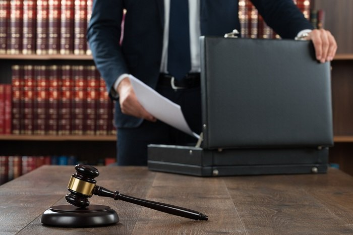 Man with law books and gavel