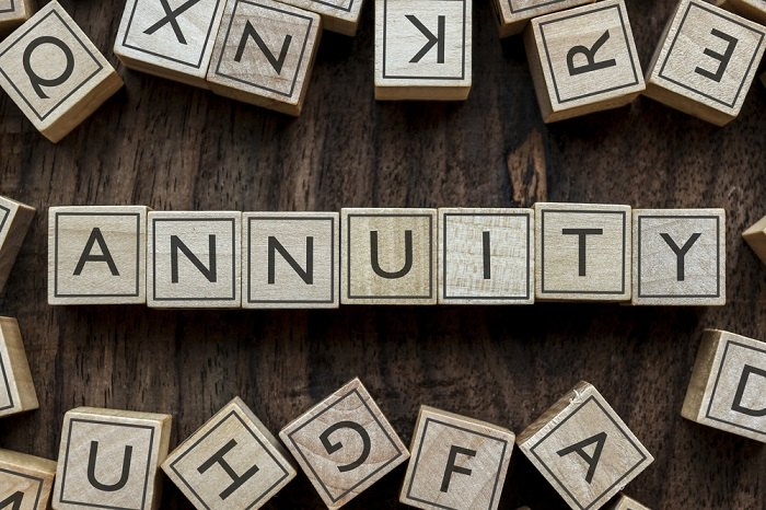 Annuity spelled out in letter tiles