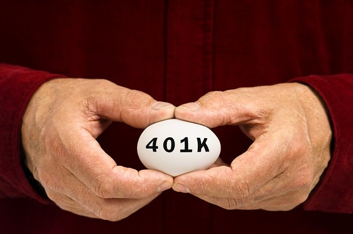 Hands holding egg with 401k written on it