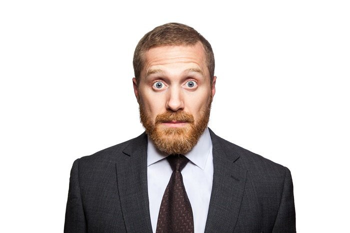 Bearded man looking shocked