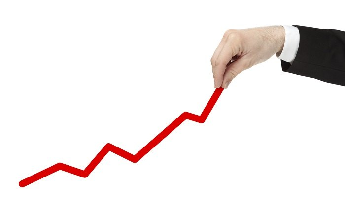 Man drawing a red line prevailing upward