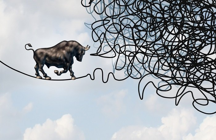 Bull on a tightrope facing knots