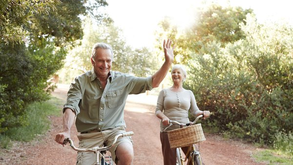 retired couple on bicycles