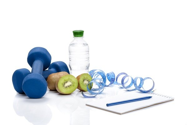 Weights, water bottle and wellness plan