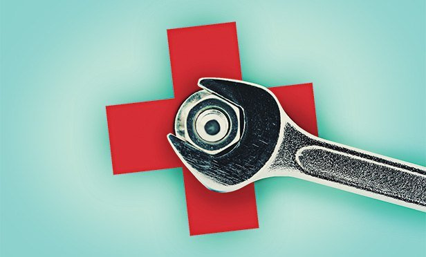 Health care symbol and wrench