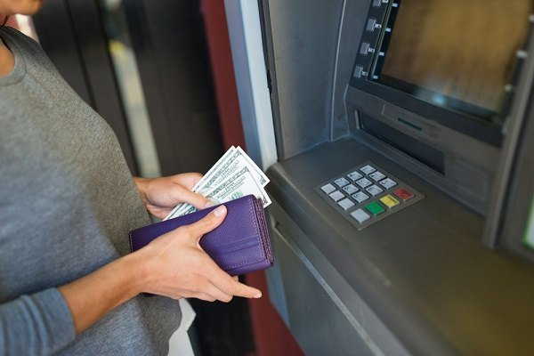 Woman getting cash at ATM