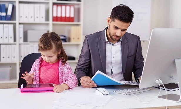Father with daughter at work