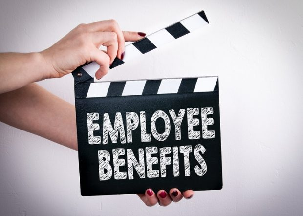Movie clapper with employee benefits on it