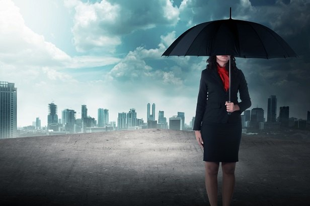 woman standing on roof with umbrella
