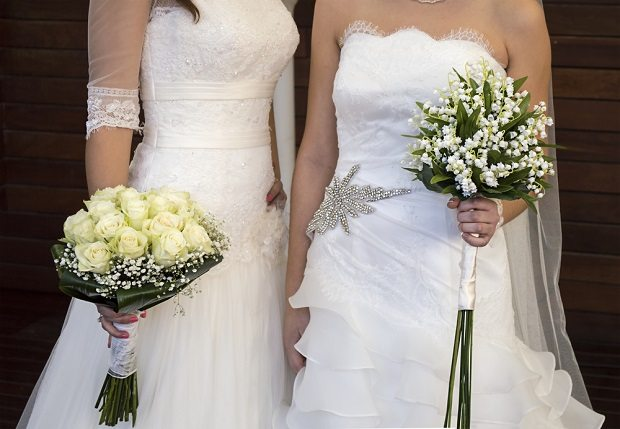 two women in wedding dresses