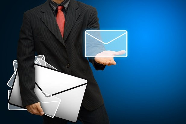 Businessman holding email