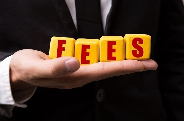 fees spelled out in mans hand