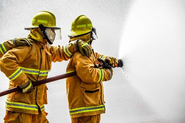 two firefighters with hose