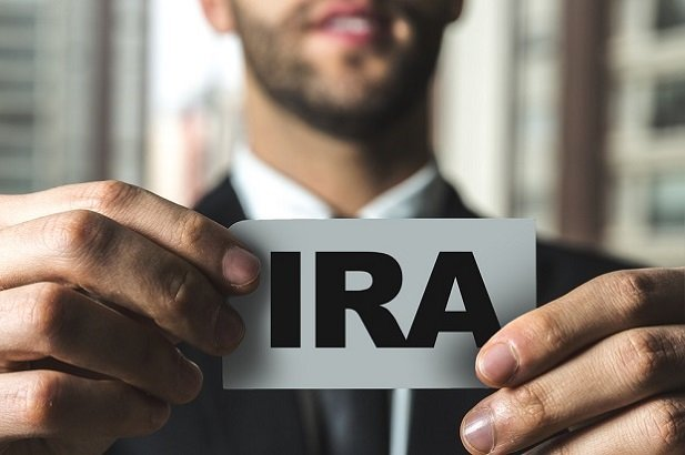 man holding card with IRA on it