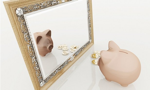 Pig looking in mirror with coins