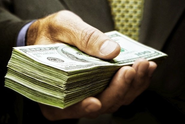 hand with stack of cash