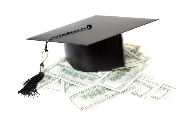 graduate's mortarboard on money
