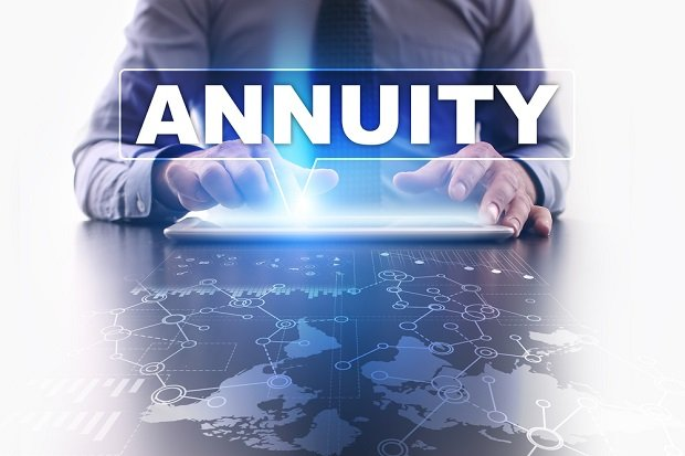 man typing the word Annuity