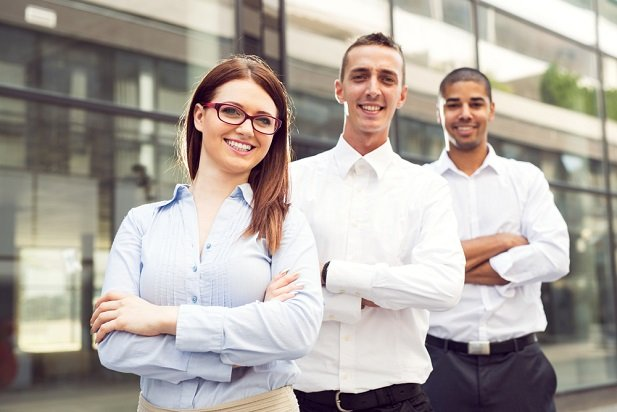 business woman and two men smiling