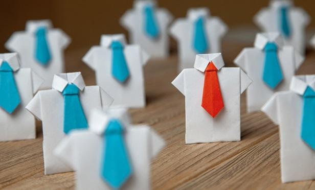 Paper cutouts of shirts and ties