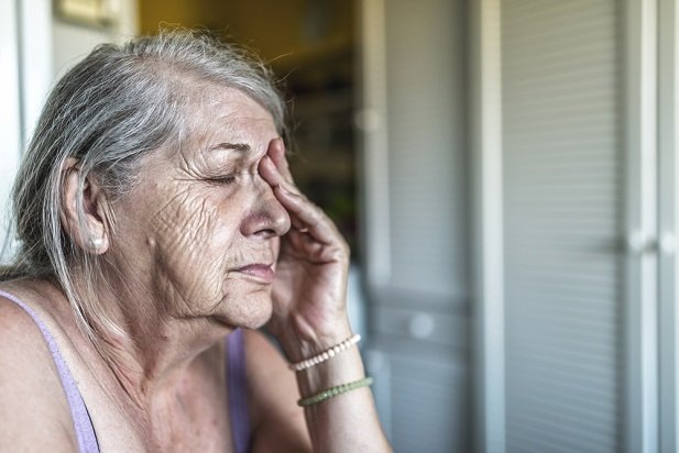 aged woman alone and sad