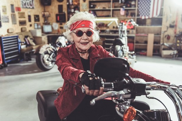 elderly woman on motorcycle
